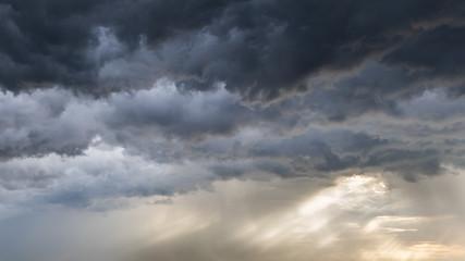 Dark stormy clouds background. Dramatic stormy sky with dark heavy clouds.