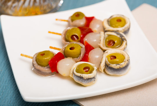 Appetizers with anchovies and vegetables