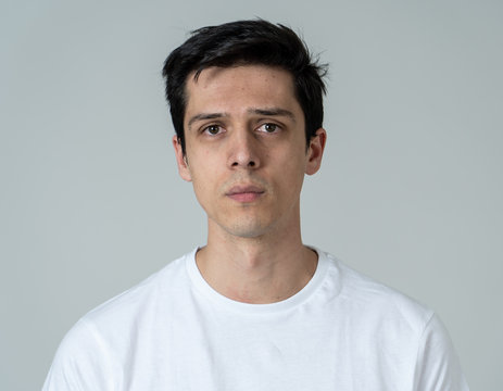 Portrait of sad and depressed man. Isolated on neutral background. Human expressions and emotions