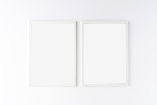 Two white photo frames with copyspace isolated on white background