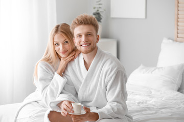 Wall Mural - Morning of happy young couple in bedroom