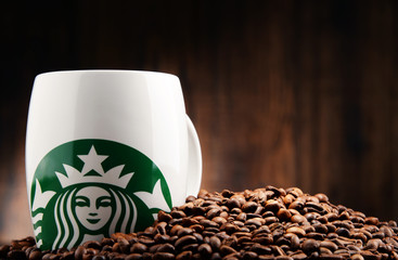 Composition with cup of Starbucks coffee
