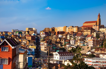 Buildings of a city with a street market of Antananarivo in sunny day. Madagascar