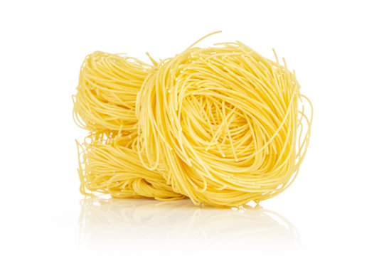 Group of three whole raw pasta angel hair isolated on white background