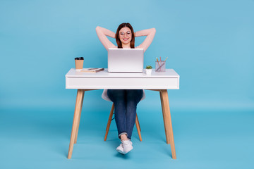 Portrait of nice lovely attractive cheerful cheery girl sitting in chair daily everyday task hr manager human resources at work place station isolated over bright vivid shine blue green background