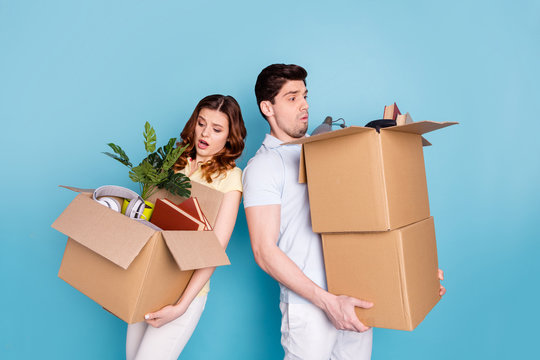 Portrait of his he her she nice-looking attractive sad unhappy upset worried nervous people carrying big large boxes packages isolated over bright vivid shine blue green background