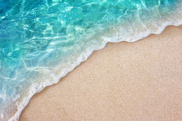 Wall Mural - Soft blue ocean wave or clear sea on clean sandy beach summer concept