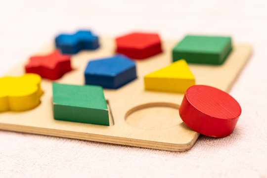 Top view closeup of colorful wooden Montessori sensorial material learning, Shape and color block. Kindergarten educational toys, Thinking process, Cognitive skills, Learn Through Play tools concept.