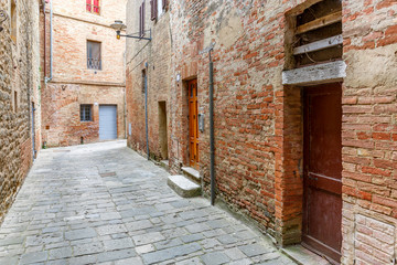 Acrylic Prints Narrow alley Doors in an old alley with paving stones