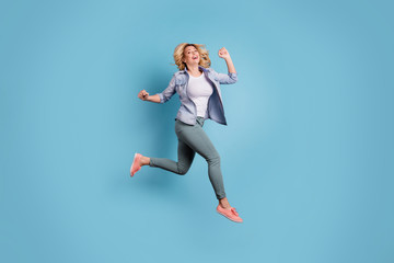 Full length photo of lovely charming person raising arms laughing wearing pants trousers isolated over blue background Fototapete