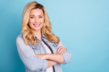 Close up photo of lovely lady with crossed arms looking smiling isolated over blue background