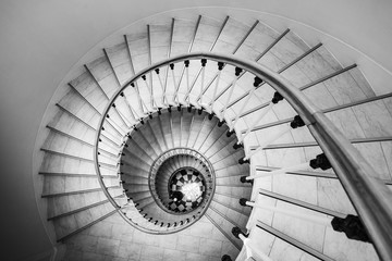 Beautiful circular staircase in old house, snail geometry