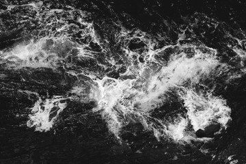 Wall Mural - Ocean sea water wave blue background. Aerial view. Black and white toned