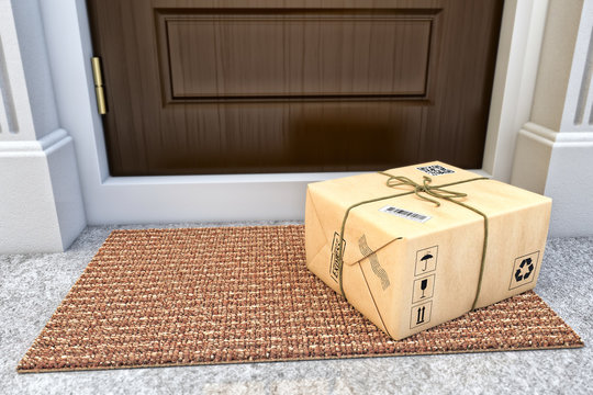 Express package delivery service concept, parcel box wrapped in craft paper on the door mat near the entrance door