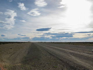 Foto op Canvas Donkergrijs Country gate, in the Patagonian landscape, with its distant horizon