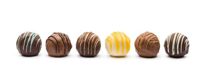 Fototapeta assorted chocolates confectionery on white background obraz