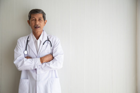 Portrait of old senior asia doctor smile with uniform