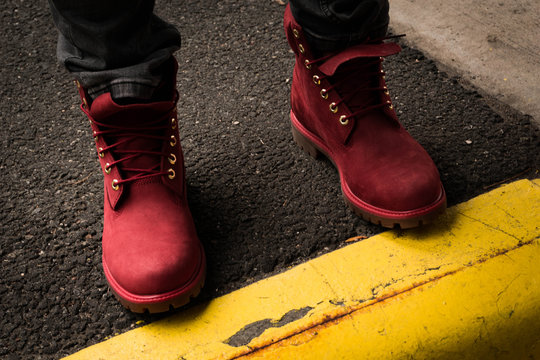 Red boots on pavement