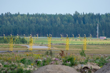 Approach light poles at the end of a runway