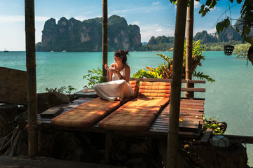 Beautiful girl resting on the sea. Lonely woman resting on the island. The girl on the Paradise coast. The girl on the Islands. A woman on a luxurious shore. Asian Islands. Holidays in Thailand Wall mural
