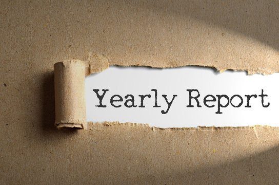 Torn paper with word Yearly Report