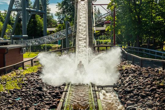 Fun water ride Log river in amusement park at summer