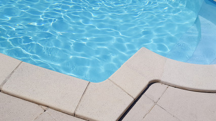Detail outdoor open air swimming pool with clean blue water in web template banner