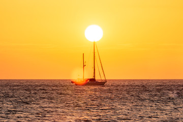 Yacht in the tropical sea at sunset