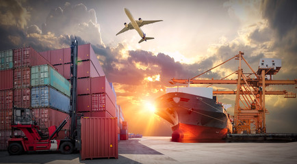 Wall Mural - Logistics and transportaIndustrial Container Cargo freight ship, forklift handling container box loading for logistic import export and transport industry concept backgroundtransport industry