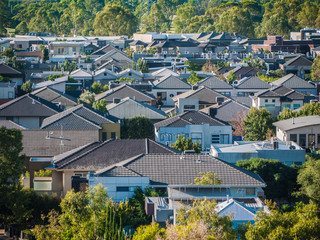 Elevated view of many residential houses in suburb. City of Maribyrnong, Melbourne VIC Australia. Concept of homes, real estate and suburban living.
