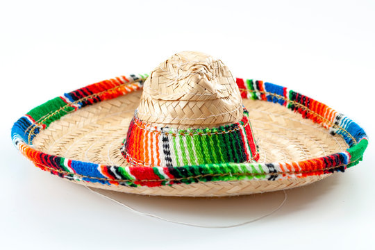 Cinco de mayo, traditional mexican hat and caribbean culture concept theme with close up on wicker or straw sombrero decorated in bright colors isolated on white background