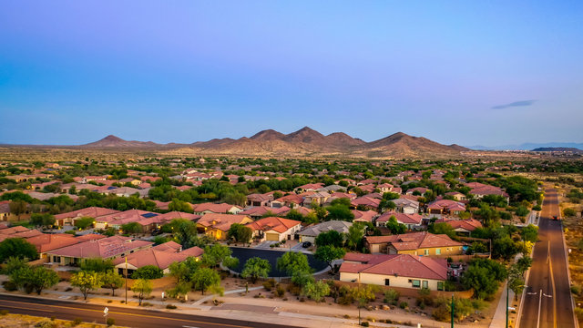 Aerial view of a desert community in Arizona during the golden hour at sunset.