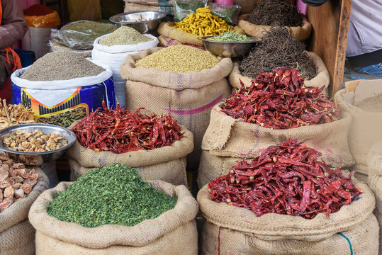 Bags and sacks with spices, seeds, roots for sale at local market in Bikaner. India