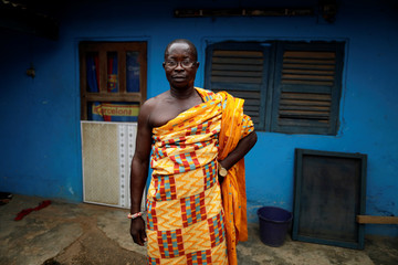 Chief Nana Boateng poses for a photograph in traditional attire at his house in Bawdie