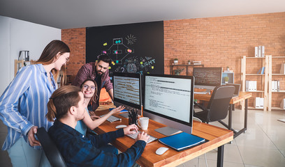 Team of programmers working in office Wall mural