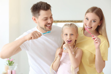 Family cleaning teeth at home
