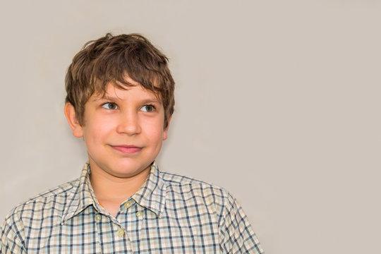 portrait of a teenage boy on a gray background