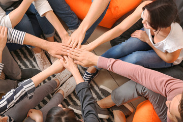 Fotomurales - People putting hands together at group therapy session