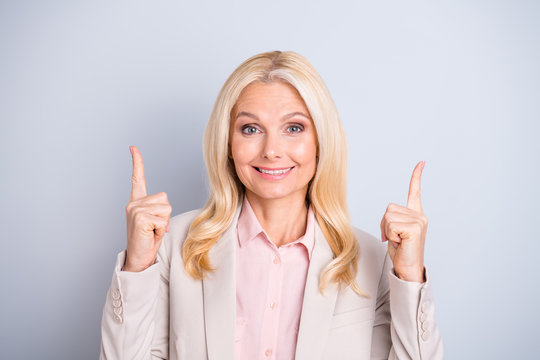 Close-up portrait of her she nice attractive stylish content cheerful cheery wavy-haired lady executive director shark expert pointing two forefingers up isolated on light white gray pastel background