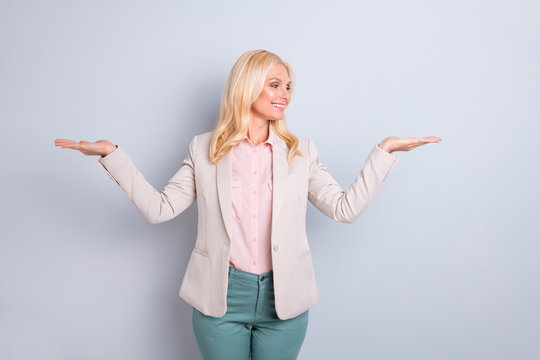Portrait of her she nice attractive charming stylish content cheerful cheery wavy-haired lady displaying holding on palms two invisible sale discount isolated on light white gray pastel background