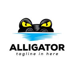 crocodile seeks prey on water logo design inspiration