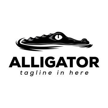 black art crocodile seeks prey on water logo design inspiration
