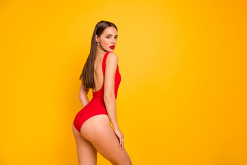 Foto op Canvas Ezel Profile side view portrait of nice-looking attractive glamorous lovely adorable posh sportive straight-haired lady perfect figure juicy shape form line isolated on bright vivid shine yellow background