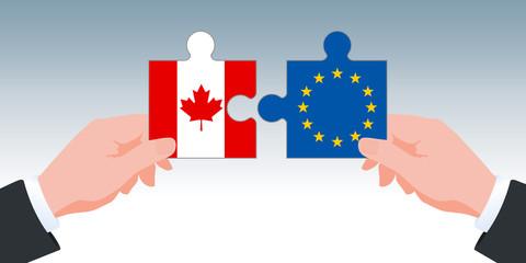 Concept de l'accord économique et commercial entre l'Union Européenne et le Canada. Le CETA est symbolisé par deux mains tenant des pièces de puzzle aux couleurs de leurs drapeaux.