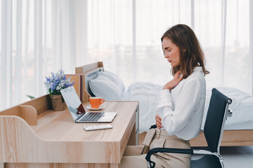 Business woman feeling painful from stomachache illness during working at office, hands touching her stomach and awareness of her Appendicitis sickness. Health insurance care. Insurance concept