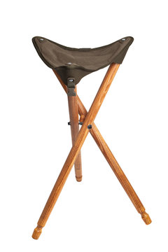 Folding wooden hunting stool tripod isolate on white background. Three-legged camping chair.