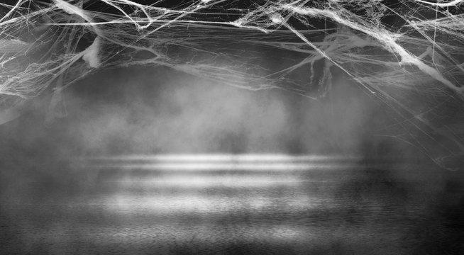 Background of empty space. Dark empty background, concrete, smoke, cobweb. Halloween background