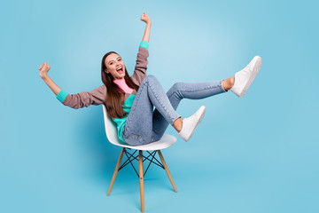 Full length body size photo of excited cheerful mad delightful emotional lady raising fists up having great mood isolated bright background