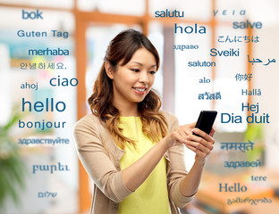 education, communication and translation concept - happy asian woman using smartphone over greeting...