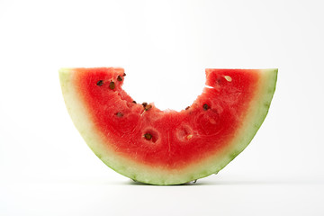 bitten off a piece of ripe red round watermelon with seeds Fototapete